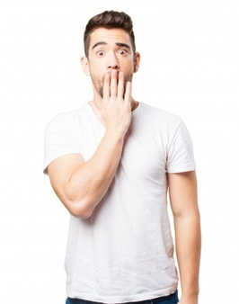 man-covering-his-mouth-with-one-hand_1187-2952